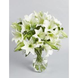 9 белых лилий в вазе